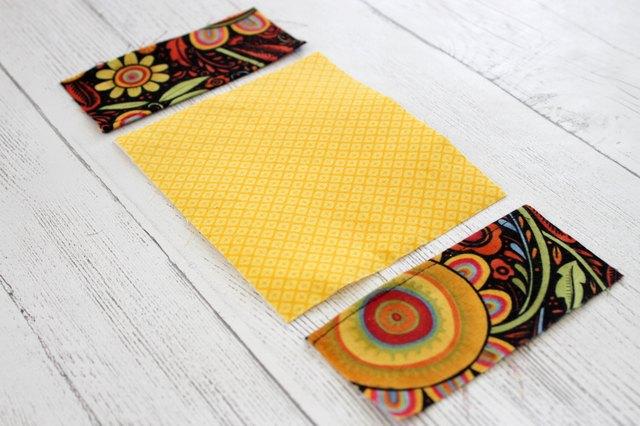 Balik potongan kain yang sudah dilapisi fusible interfacing agar sisi yang baik terlihat